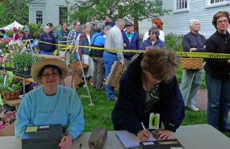 Cashiers at the ready as early-arrivals wait for the 10am bell to ring and open the fair!